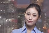 Smiling businesswoman, cityscape of Beijing — Stock Photo