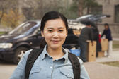 Student in front of dormitory at college — Stock Photo