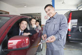 Mechanic Helping Family with Their Car — Photo