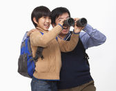 Father and son with binoculars — Stock Photo