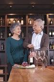 Senior Couple Opening Wine Bottle — Stock Photo