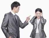 Businessman shouting at businesswoman — Stock Photo