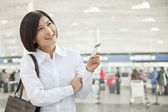 Woman Holding an Airplane Ticket — Stock Photo