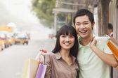 Young couple at the bus stop — Stock Photo