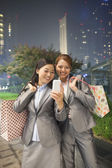 Businesswomen taking self-portrait with Cell Phone — Stock Photo