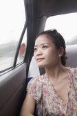 Woman Looking Out Window In Taxi — Stock Photo
