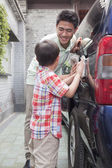 Father and Son Clean their Minivan Together — Stock Photo
