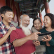 Chinese Family Looking At Digital Tablet In Jing Shan Park — Stock Photo #36350297