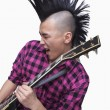 Young mwith punk Mohawk playing guitar — Stock Photo #36350881