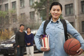 Family in front of dormitory at college — Stock Photo