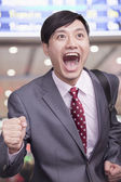 Businessman running through airport — Stock Photo