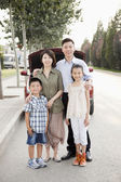Family Portrait in Front of Car on Roadside — Photo