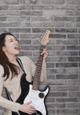 Woman Playing a Electric Guitar — Stock Photo