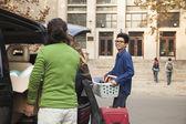 Man moving into dormitory on college campus — Stock Photo