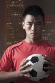 Footballer holding ball — Stock Photo