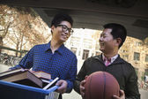 Father and Son in back of car in front of dormitory — Stock Photo