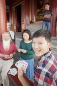 Chinese Family Playing Card In Jing Shan Park — Stock Photo