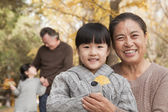 Grandparents and granddaughters in park — Stock Photo