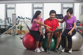 People looking at digital tablet in the gym — Stock Photo