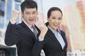 Business man and woman cheering — Stock Photo