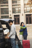 Family moving their son into dormitory on college campus — Stock Photo