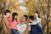People playing piggyback in park — Stock Photo