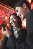 Coworkers using smart phone at night — Foto Stock