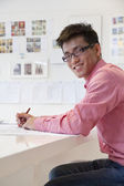 Businessman working on architecture project — Stock Photo