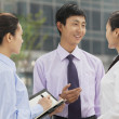 Business people talking outdoors — Stock Photo #36399407