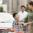 Family with shopping cart — Stock Photo