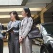 Businesswomen meeting and talking in parking garage — Stock Photo