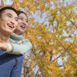 Couple piggyback in park — Stock Photo #36398773