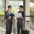 Two young businessmen working outdoor — Stock Photo