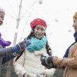 Stock Photo: Friends Having Snowball Fight
