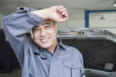 Auto Mechanic Wiping the Sweat Off His Brow — Stock Photo