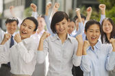Business people cheering with fists up — Stock Photo