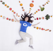 Woman with fresh fruit and vegetables in lines and patterns — Stock Photo