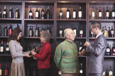 People Examining Wine at a Wine Store — Stock Photo