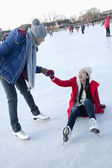 Couple at ice rink — Stock Photo