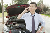 Businessman Calling for Roadside Assistance — Stock Photo