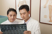 Doctor and Nurse Examine an X-Ray — Foto de Stock
