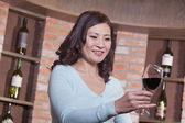 Mature Woman Looking at Wineglass — Stock Photo