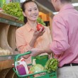 Couple buying vegetables in supermarket — Stock Photo