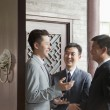Stock Photo: Businessmen in Doorway