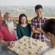 Chinese Family Playing Chinese Chess — Stock Photo