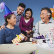 Family celebrating mum's birthday — Stock Photo