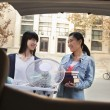 Stock Photo: Sisters moving into dormitory at college