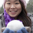 Stock Photo: Womwith Snowball