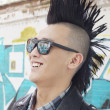 Young man with punk Mohawk smiling — Stock Photo #36401815