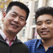 Stock Photo: Father and son portrait in front of dormitory